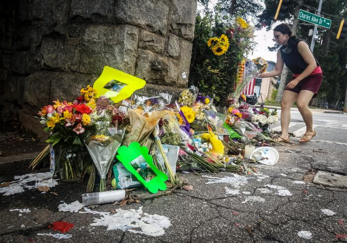 A makeshift memorial to Katherine Janness is seen at the entrance to Piedmont Park in Atlanta.